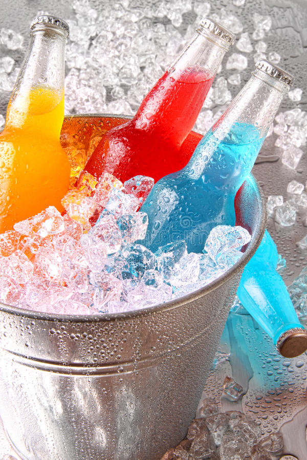 Download Bottles Of Cooler Drinks With Ice Stock Photo - Image: 20322182