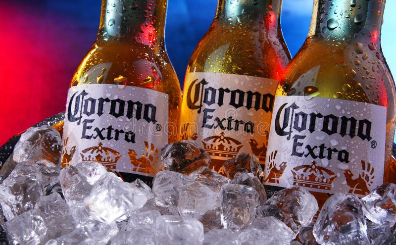 Bottles of Corona Extra beer in the bucket with crushed ice. POZNAN, POL - SEP 5, 2019: Bottles of Corona Extra, one of the top-selling beers worldwide, a pale royalty free stock images