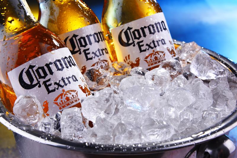 Bottles of Corona Extra beer in the bucket with crushed ice. POZNAN, POL - SEP 5, 2019: Bottles of Corona Extra, one of the top-selling beers worldwide, a pale stock images