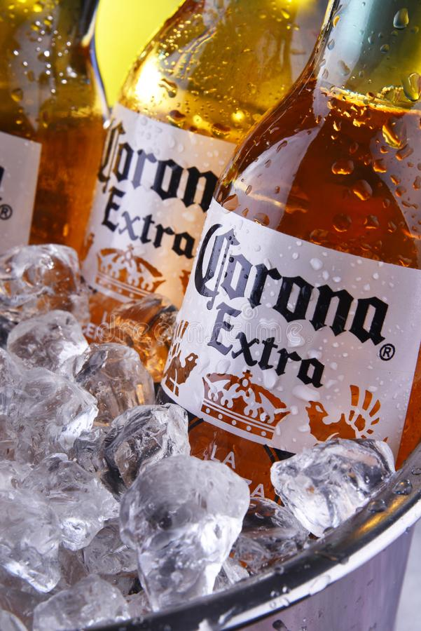 Bottles of Corona Extra beer in the bucket with crushed ice. POZNAN, POL - SEP 5, 2019: Bottles of Corona Extra, one of the top-selling beers worldwide, a pale stock photos