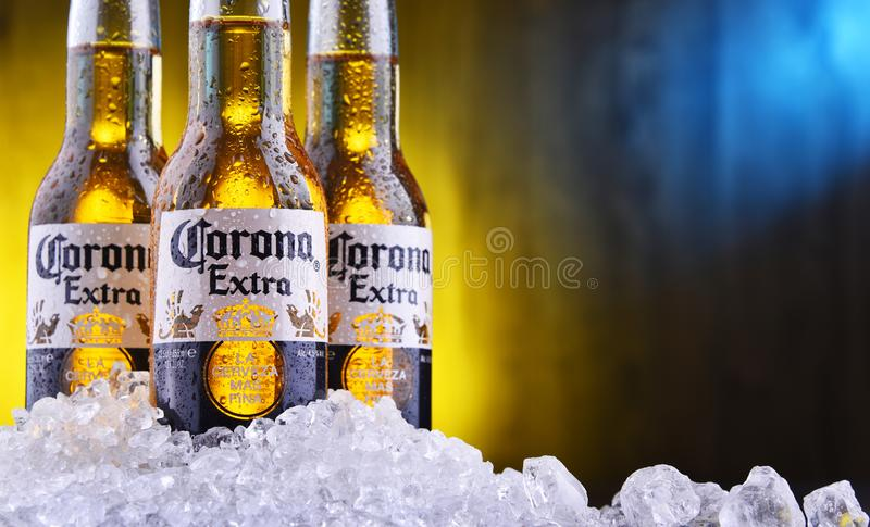 Bottles of Corona Extra beer. POZNAN, POL - AUG 22, 2019: Bottles of Corona Extra, one of the top-selling beers worldwide, a pale lager produced by Cerveceria royalty free stock image
