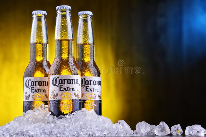 Bottles of Corona Extra beer. POZNAN, POL - AUG 22, 2019: Bottles of Corona Extra, one of the top-selling beers worldwide, a pale lager produced by Cerveceria stock photography