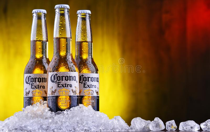 Bottles of Corona Extra beer. POZNAN, POL - AUG 22, 2019: Bottles of Corona Extra, one of the top-selling beers worldwide, a pale lager produced by Cerveceria royalty free stock photo