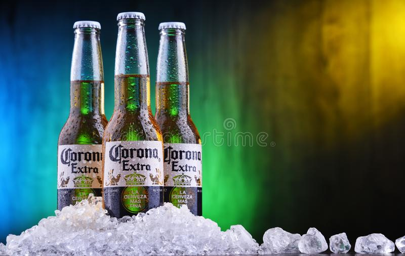 Bottles of Corona Extra beer. POZNAN, POL - AUG 22, 2019: Bottles of Corona Extra, one of the top-selling beers worldwide, a pale lager produced by Cerveceria royalty free stock images