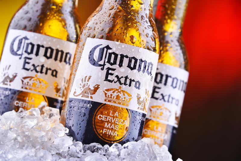 Bottles of Corona Extra beer. POZNAN, POL - AUG 22, 2019: Bottles of Corona Extra, one of the top-selling beers worldwide, a pale lager produced by Cerveceria stock image