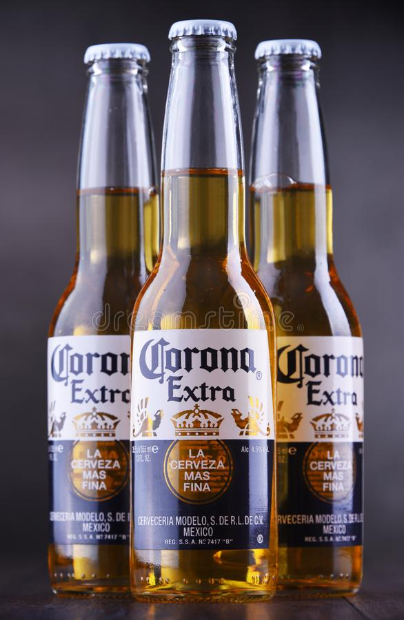 Bottles of Corona Extra beer. POZNAN, POL - JAN 24, 2019: Bottles of Corona Extra, one of the top-selling beers worldwide, a pale lager produced by Cerveceria stock image