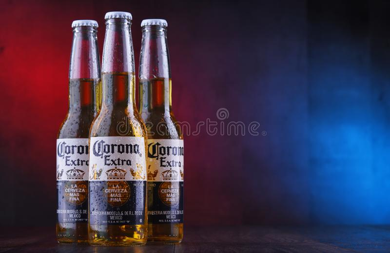 Bottles of Corona Extra beer. POZNAN, POL - JAN 24, 2019: Bottles of Corona Extra, one of the top-selling beers worldwide, a pale lager produced by Cerveceria stock images