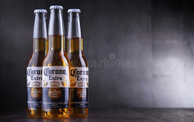 Bottles of Corona Extra beer. POZNAN, POL - JAN 24, 2019: Bottles of Corona Extra, one of the top-selling beers worldwide, a pale lager produced by Cerveceria royalty free stock images
