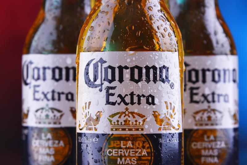 Bottles of Corona Extra beer. POZNAN, POL - JAN 24, 2019: Bottles of Corona Extra, one of the top-selling beers worldwide, a pale lager produced by Cerveceria royalty free stock photo