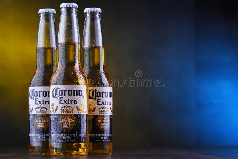 Bottles of Corona Extra beer. POZNAN, POL - JAN 24, 2019: Bottles of Corona Extra, one of the top-selling beers worldwide, a pale lager produced by Cerveceria stock photos