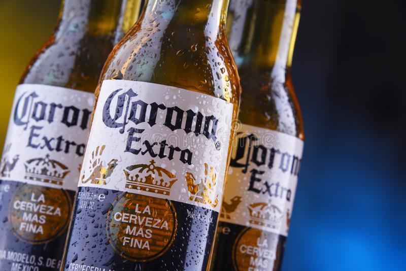 Bottles of Corona Extra beer. POZNAN, POL - JAN 24, 2019: Bottles of Corona Extra, one of the top-selling beers worldwide, a pale lager produced by Cerveceria stock photography