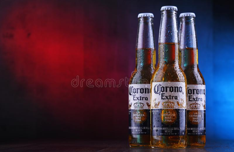 Bottles of Corona Extra beer. POZNAN, POL - JAN 24, 2019: Bottles of Corona Extra, one of the top-selling beers worldwide, a pale lager produced by Cerveceria royalty free stock image