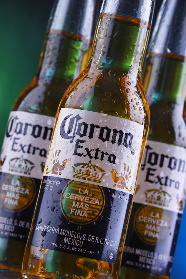 Bottles of Corona Extra beer. POZNAN, POL - JAN 24, 2019: Bottles of Corona Extra, one of the top-selling beers worldwide, a pale lager produced by Cerveceria royalty free stock photography