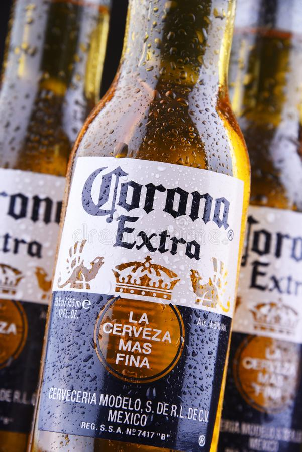 Bottles of Corona Extra beer. POZNAN, POL - MAR 28, 2019: Bottles of Corona Extra, one of the top-selling beers worldwide, a pale lager produced by Cerveceria royalty free stock images