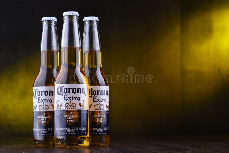 Bottles of Corona Extra beer. POZNAN, POL - MAR 28, 2019: Bottles of Corona Extra, one of the top-selling beers worldwide, a pale lager produced by Cerveceria royalty free stock photo