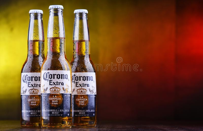Bottles of Corona Extra beer. POZNAN, POL - MAR 28, 2019: Bottles of Corona Extra, one of the top-selling beers worldwide, a pale lager produced by Cerveceria royalty free stock image