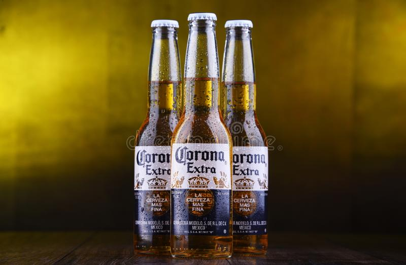 Bottles of Corona Extra beer. POZNAN, POL - MAR 28, 2019: Bottles of Corona Extra, one of the top-selling beers worldwide, a pale lager produced by Cerveceria royalty free stock photos