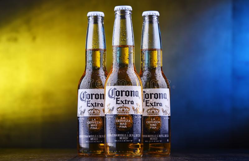 Bottles of Corona Extra beer. POZNAN, POL - MAR 28, 2019: Bottles of Corona Extra, one of the top-selling beers worldwide, a pale lager produced by Cerveceria stock photo