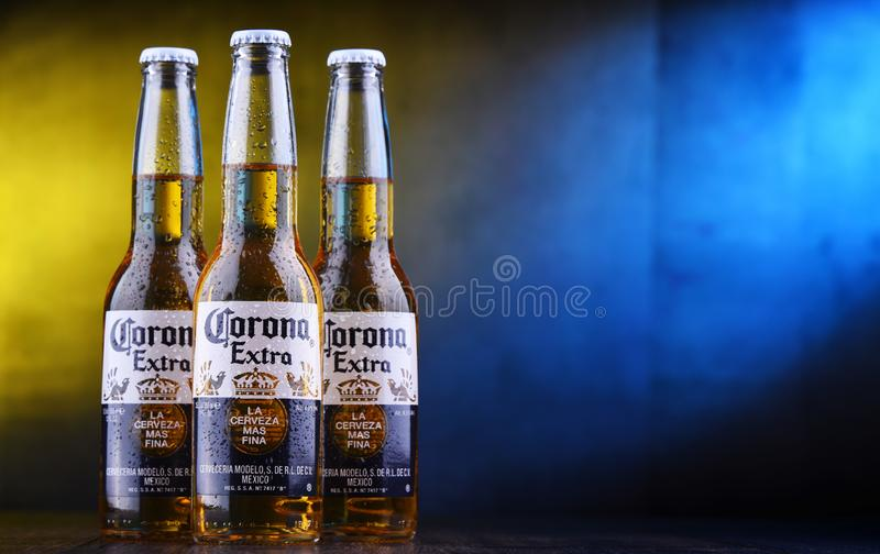 Bottles of Corona Extra beer. POZNAN, POL - MAR 28, 2019: Bottles of Corona Extra, one of the top-selling beers worldwide, a pale lager produced by Cerveceria stock image