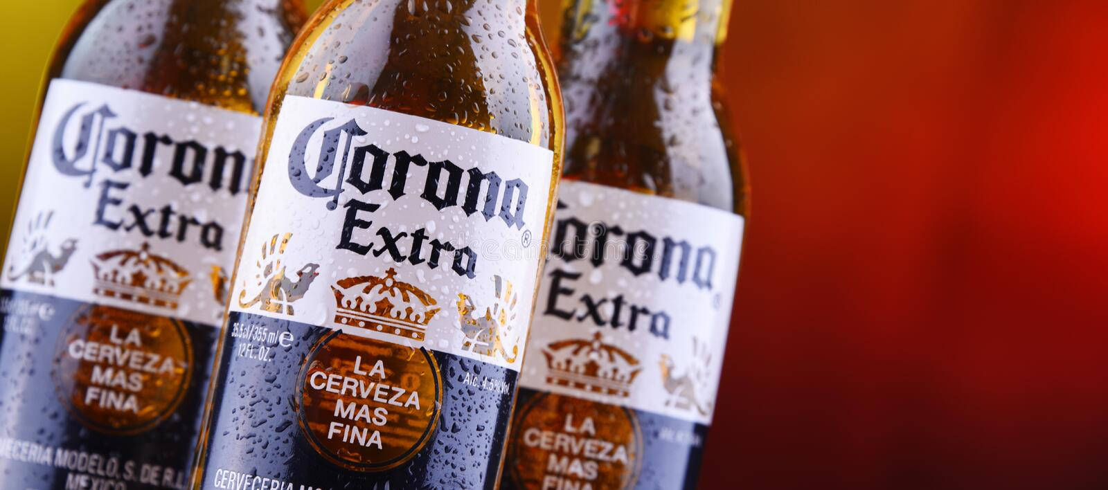 Bottles of Corona Extra beer. POZNAN, POL - MAR 28, 2019: Bottles of Corona Extra, one of the top-selling beers worldwide, a pale lager produced by Cerveceria stock photography