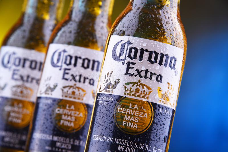 Bottles of Corona Extra beer. POZNAN, POL - MAR 28, 2019: Bottles of Corona Extra, one of the top-selling beers worldwide, a pale lager produced by Cerveceria stock photos