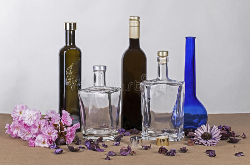 Bottles and decoration. Different bottles and decoration in studio royalty free stock images