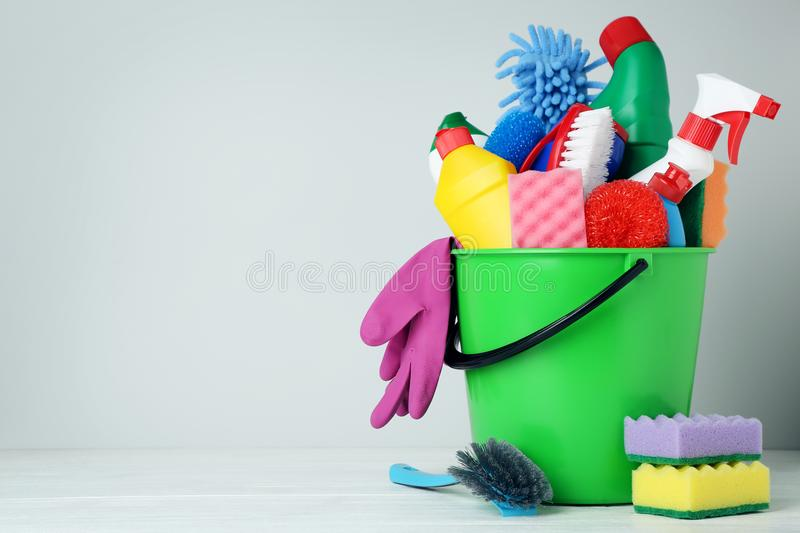 Bottles with detergent and cleaning tools royalty free stock photography