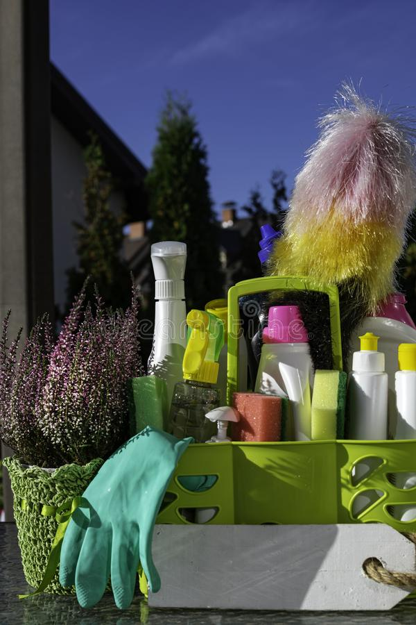 Bottles with detergent and cleaning tools outdoor stock photos