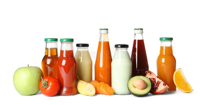 Bottles with different drinks and ingredients stock images