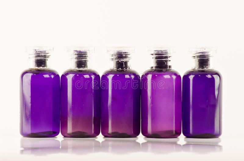 Bottles with essential oils. Blue bottles with essential oils stock photo