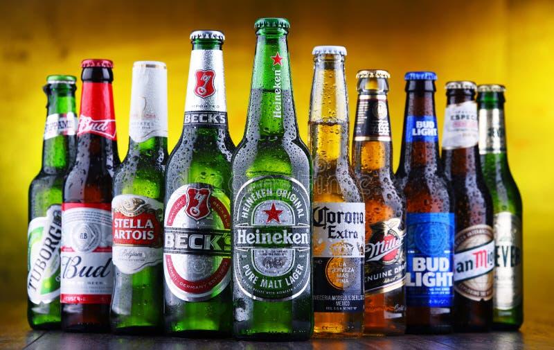 Bottles of famous global beer brands. POZNAN, POL - MAR 15, 2019: Bottles of famous global beer brands including Heineken, Becks, Bud, Miller, Corona, Stella stock photo