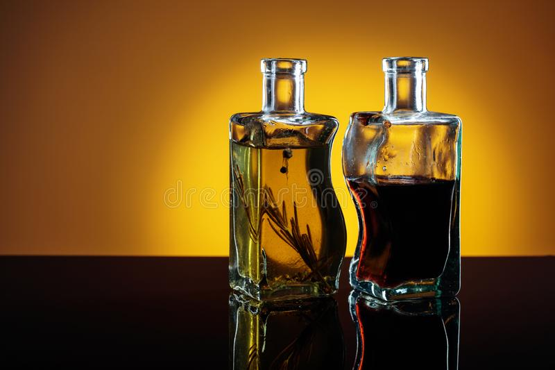 Bottles of flavored olive oil and balsamic vinegar . royalty free stock photo