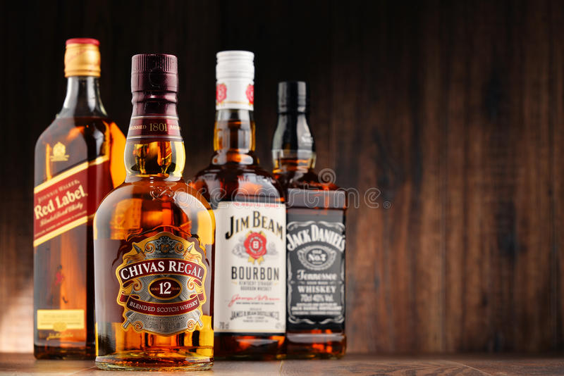 Bottles of four whiskey brands from usa and scotland for Most popular whiskey drinks