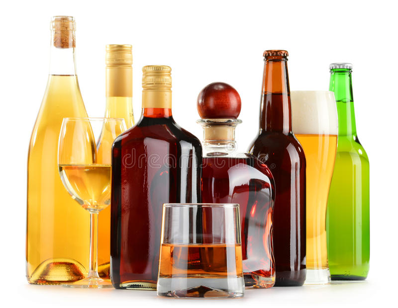 Bottles and glasses of assorted alcoholic beverages over white. Bottles and glasses of assorted alcoholic beverages on white background stock photography