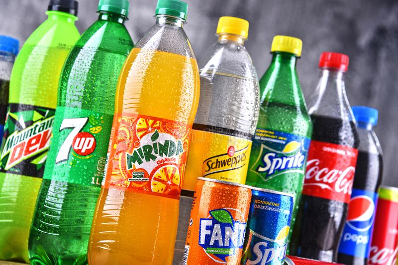 Bottles of global soft drink brands. POZNAN, POLAND - APR 6, 2018: Bottles of global soft drink brands including products of Coca Cola Company and Pepsico royalty free stock photography