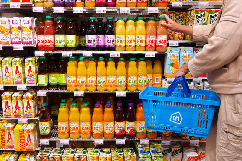 Bottles of juice in Supermarket royalty free stock photos