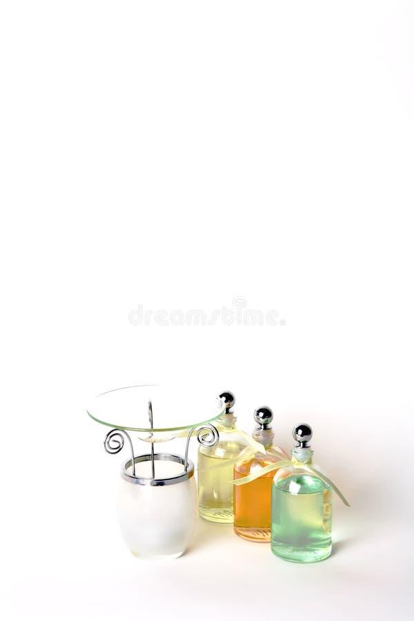 bottles klara nödvändiga höga key lightingoljor för gasbrännaren royaltyfri bild
