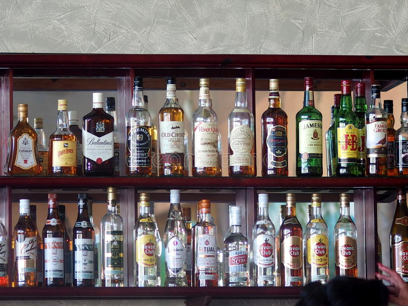 Bottles Of Liquor At Hotel In Cuba stock images