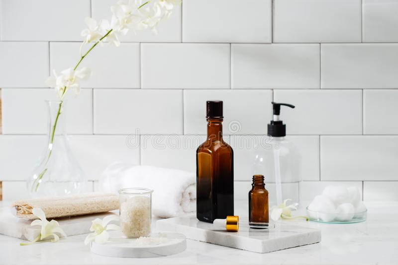Bottles with massage essentials oils, towels and zen stones. Spa composition royalty free stock photo