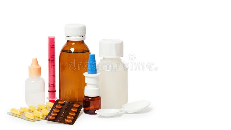 Bottles with medicine, nasal spray. Cough syrup, antipyretic syrup and nose drops on white background. Medication for cold treatme royalty free stock images