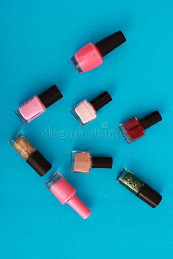 Bottles of nail polish. On a colorful blue background stock photo