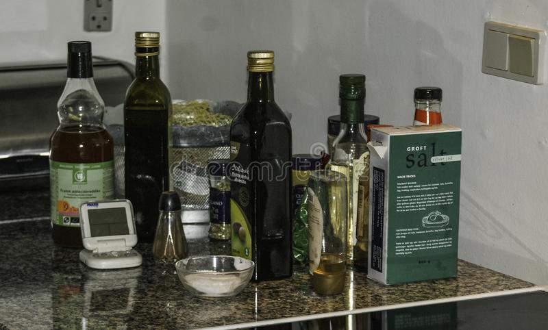 Oils spices and cooking items on countertop royalty free stock photo