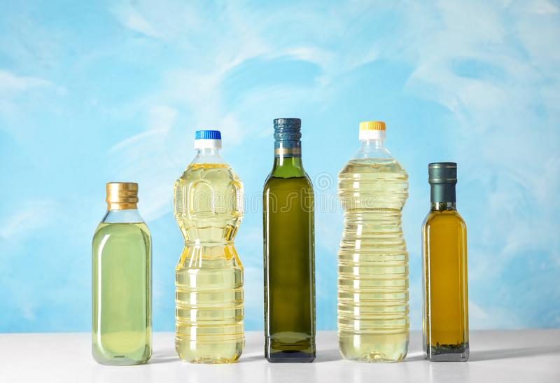 Bottles of oils on table royalty free stock photo