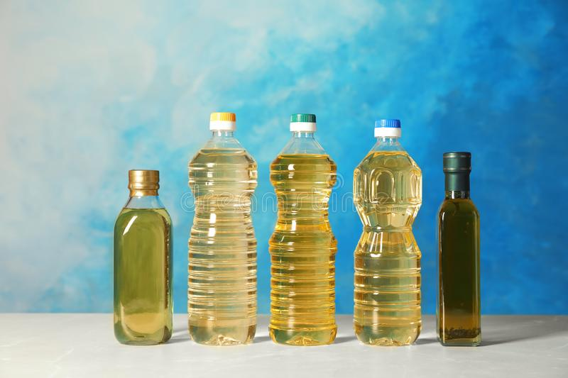 Bottles of oils on table royalty free stock image