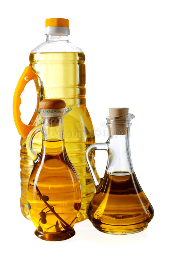 Bottles of olive oil and sunflower stock photos