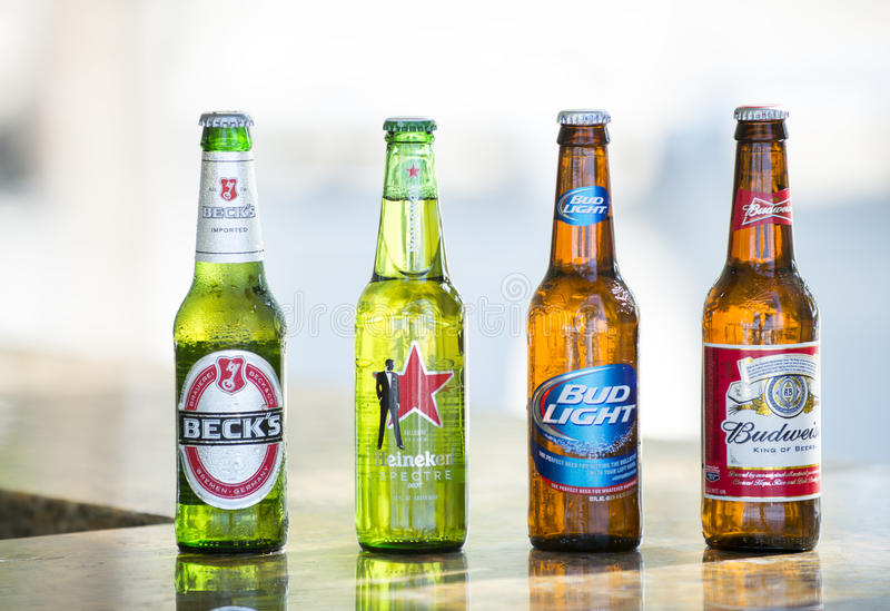 Bottles of popular assorted beers. Key West, Florida, USA - January 08, 2016: Popular four bottle of assorted cold beers including Beck's, Heiniken Spectre, Bud royalty free stock images