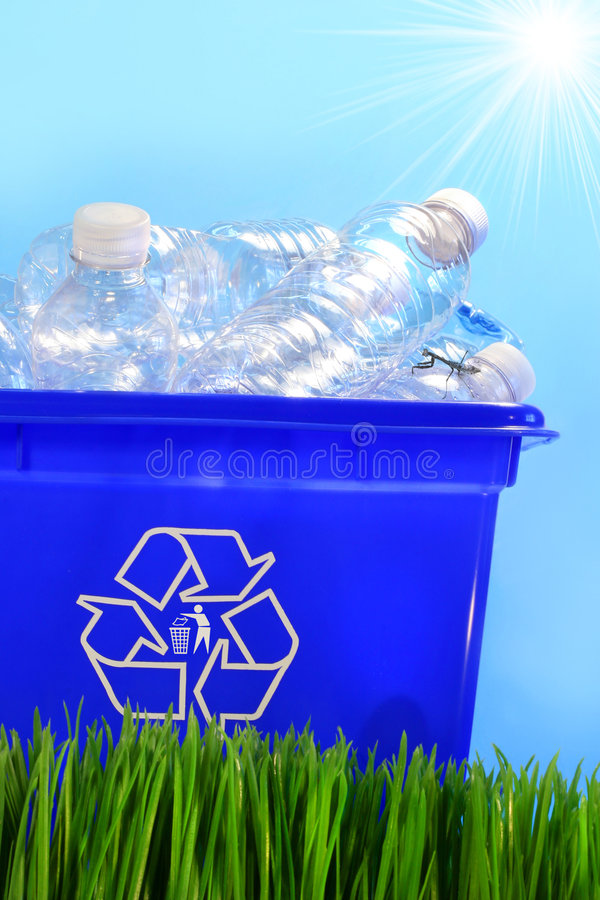 Bottles in recycling container bin. In the grass royalty free stock images