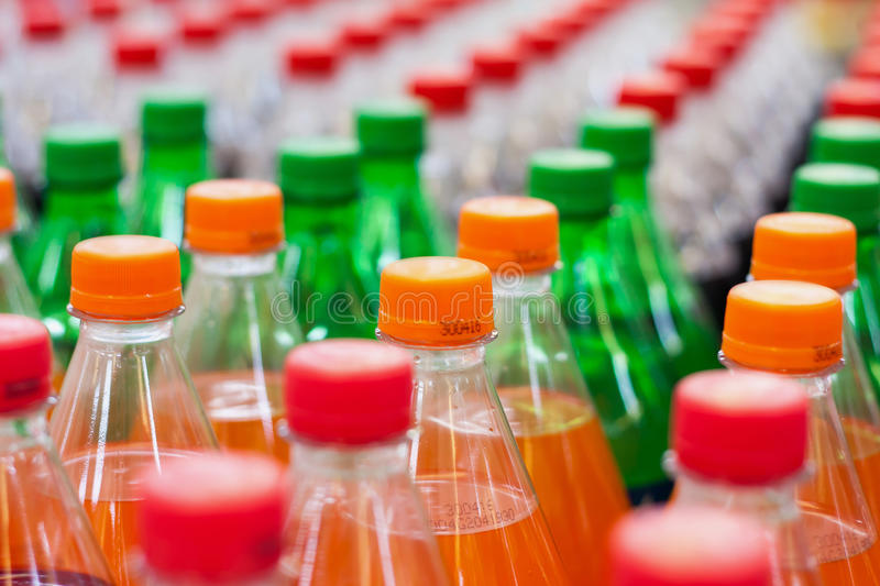 Bottles with soft drinks. Plastic bottles with soft drinks background stock photography