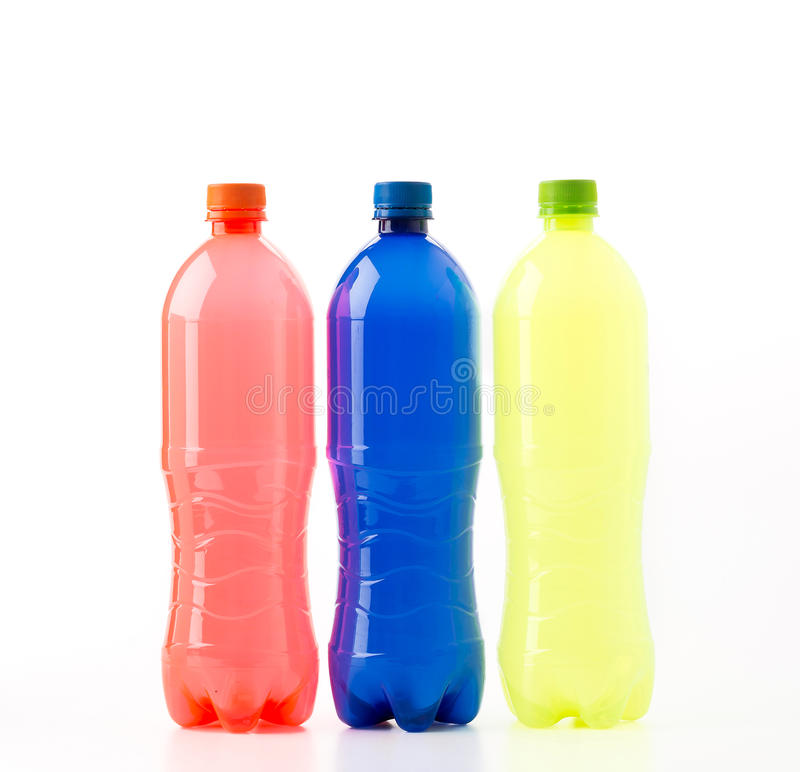 Bottles of soft drinks. On white background stock image