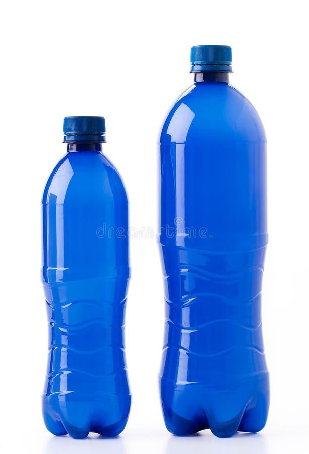 Bottles of soft drinks. On white background royalty free stock image